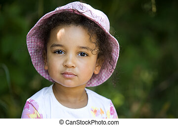 Cute and Curly - A cute little mixed race girl