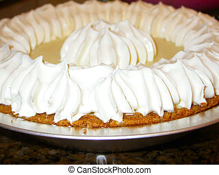 Banana Cream Pie - A close up image of a banana cream pie