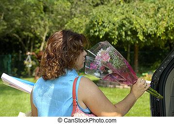 Shopping - Woman Unloading Trunk After Shopping
