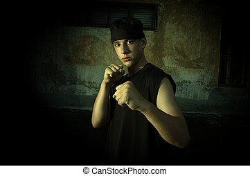 Street combat - Young fighterspecial photo fx with dark...