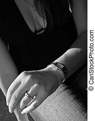 newlywed - young woman showing off her ring in selective...