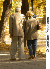 Autumn walk - Autumn meeting of middle age couple leading by...