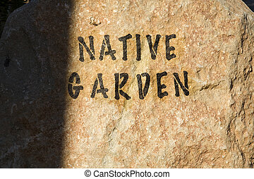 "Stock Photo of a Rock with \""Native Garden\\\"" Painted on..."