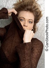 undress - pretty girl in brown sweater