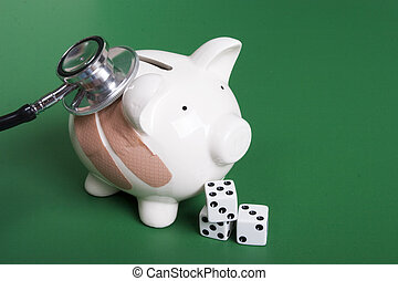 Piggy bank with dice - Gambling health of your finances