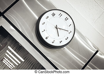 Clock - Stylish wall clock in library