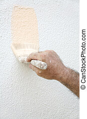 Painter\\\'s Hand - A man\\\'s paint-spattered hand holding...