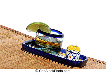 Tequila in decorative glass with lime and salt