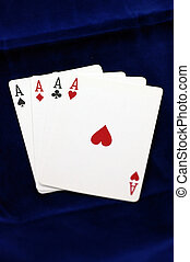Four Aces Spades, Diamonds, Clubs, and Hearts against a dark...