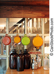 Country kitchen - Bottles and pans in an old-style country...