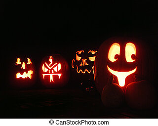 Halloween Pumpkins - A set of four carved Halloween pumpkins...