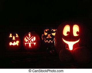 Halloween Pumpkins - A set of four carved Halloween pumpkins...