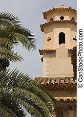 Church tower with palm tree to left