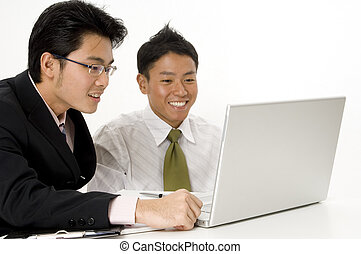Happy Laptop Business - Two young men look happy with their...
