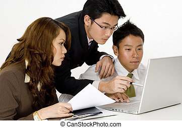 Asian Business Team - Three young asian executives working...
