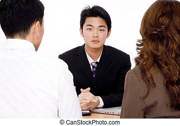 Financial Advisor - A young chinese man interviews a young...