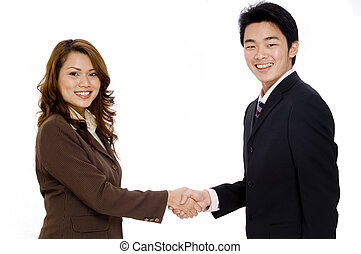 Business Deal - Two smiling young executives shaking hands