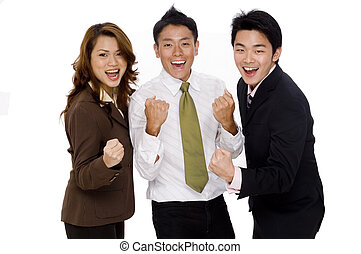 Successful Group Business - Three young executives punch the...