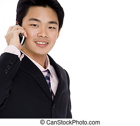 Business Call - A young asian businessman on the phone