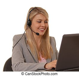 Working Help Desk - Business lady at computer with headset