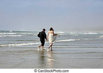 bride&groom - bride and groom on ocean beach, West Coast...