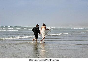 bride&groom - bride and groom on ocean beach, West Coast...