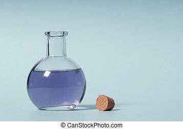 Lavender oil - Bottle on blue background
