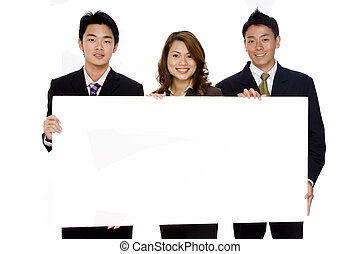 Business Sign - Three young asian business people hold up a...