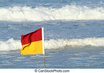 Windy Day - A lifesaving flag on the Gold Coast of Australia...