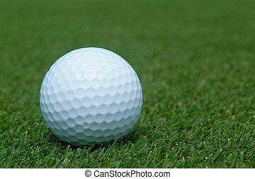 Golf-ball on green. Close-up with shallow depth of field.