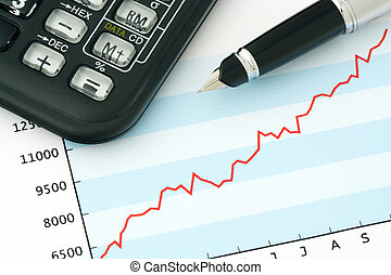 Pen and Calculator on Positive Earning Graph - Financial...