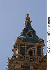 Monastery tower against a blue sky