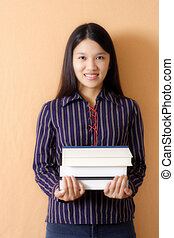 Smiling student - A student carrying books