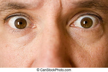 Stock Photo of the Eyes of a Surprised Man