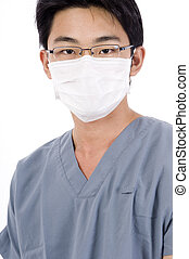 Male Nurse - A young male asian nurse in medical scrubs and...