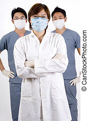 Medical Personnel - Three young medical personnel in doctors...