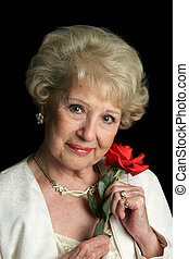 Beautiful Senior Lady with Rose - A portrait of a beautiful...