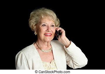 Senior Lady on Cell Phone - A sophisticated senior lady...