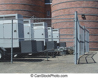 Generators behind a fence ,the town name is rosemere on them...