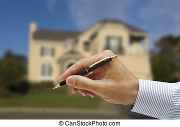 sign here - mans hand holding a pen, pinstriped shirt, house...