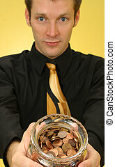 Pennies - Attractive 26 year old businessman with jar of...
