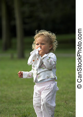 Little two year old outdoors in the park