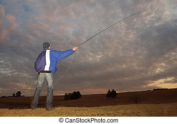 Flyfishing 1 - A fly fisherman casting a line in Dullstroom,...