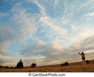 Flyfishing #4 - A fly fisherman casting a line in...