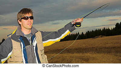 Flyfishing 5 - A fly fisherman casting a line in Dullstroom,...
