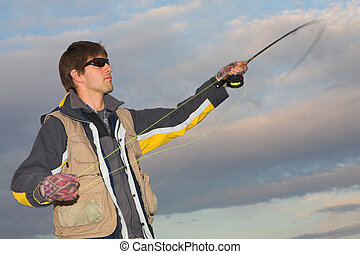 Flyfishing 6 - A fly fisherman casting a line in Dullstroom,...