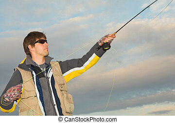 Flyfishing 7 - A fly fisherman casting a line in Dullstroom,...