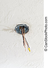 Ceiling Box and Wire - A ceiling box for a fan properly...