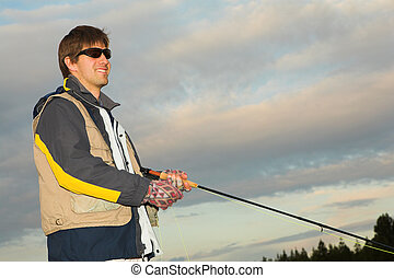 Flyfishing 9 - A fly fisherman casting a line in Dullstroom,...