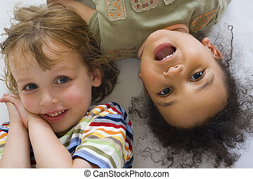 Up Close & Laughing - A young blond boy and a beautiful...